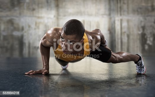 istock Sport. Young athletic man doing push-ups. 533994018