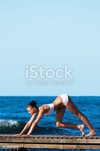 816941230istockphoto Sportif woman stretching in exercise fitness at pier 512682322