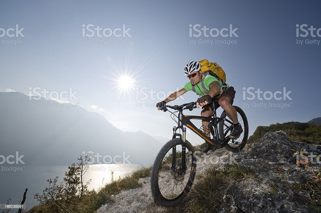 Sporting man riding on single track trail stock photo