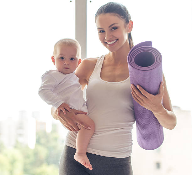 Sporting mom and baby stock photo