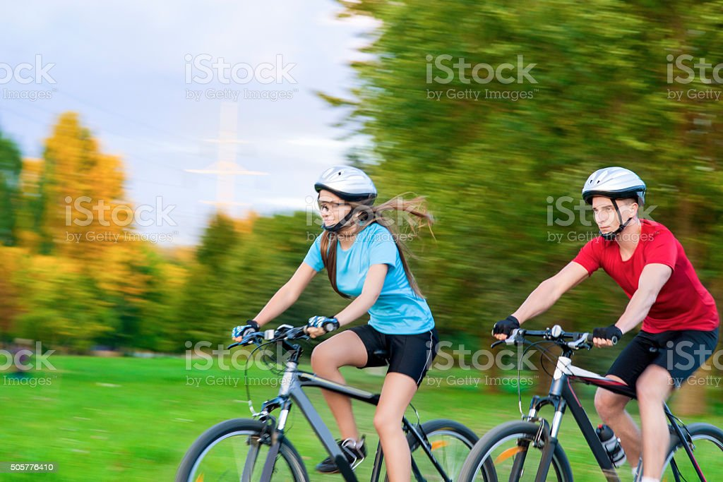 Sportive caucasian Couple Cycling Outdoors stock photo