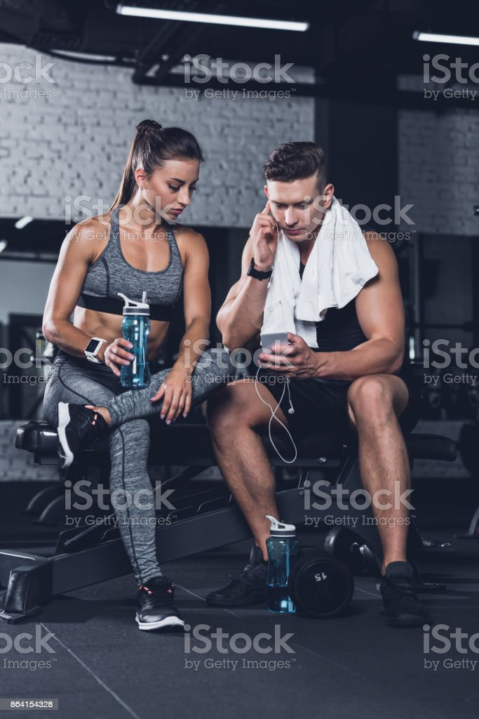 sportive couple with smartphone royalty-free stock photo