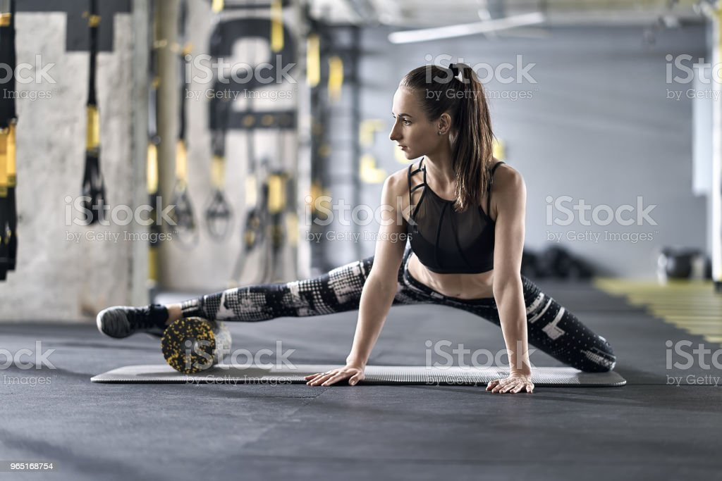 Sportive girl training in gym royalty-free stock photo