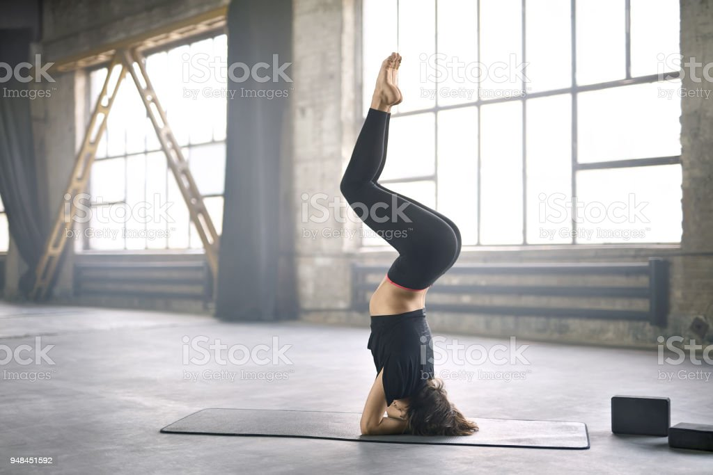 Sportive girl yoga training stock photo