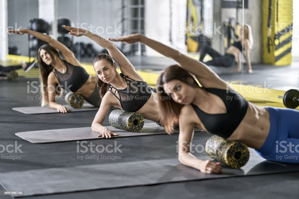 Sportive girls training in gym royalty-free stock photo