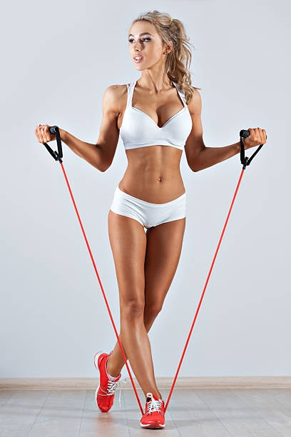 Sportive woman doing skipping rope in the gym stock photo
