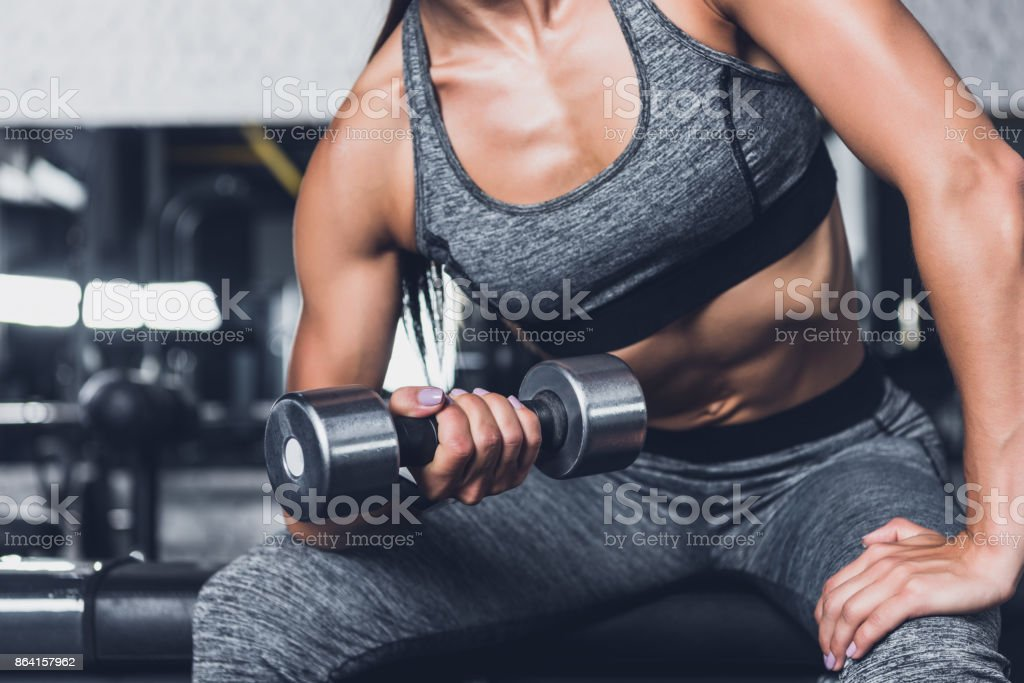 sportive woman exercising with dumbbell royalty-free stock photo