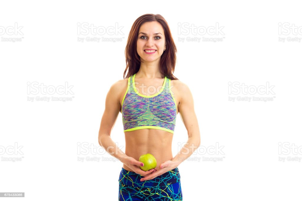 Sportive woman holding apple royalty-free stock photo