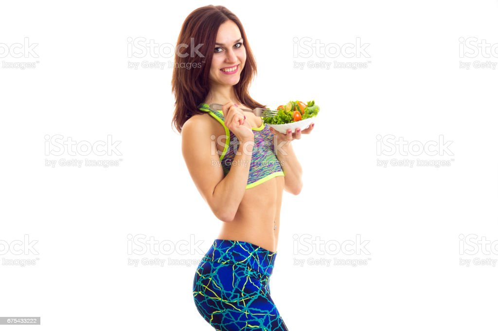 Sportive woman holding salad royalty-free stock photo