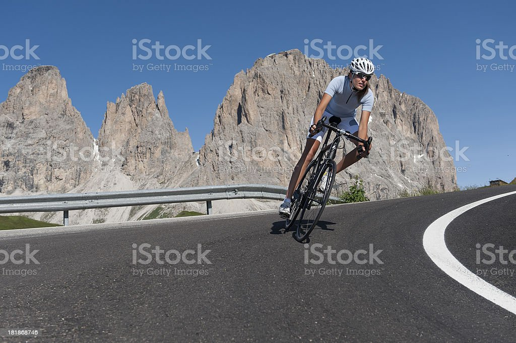 sportive woman on bicycle stock photo