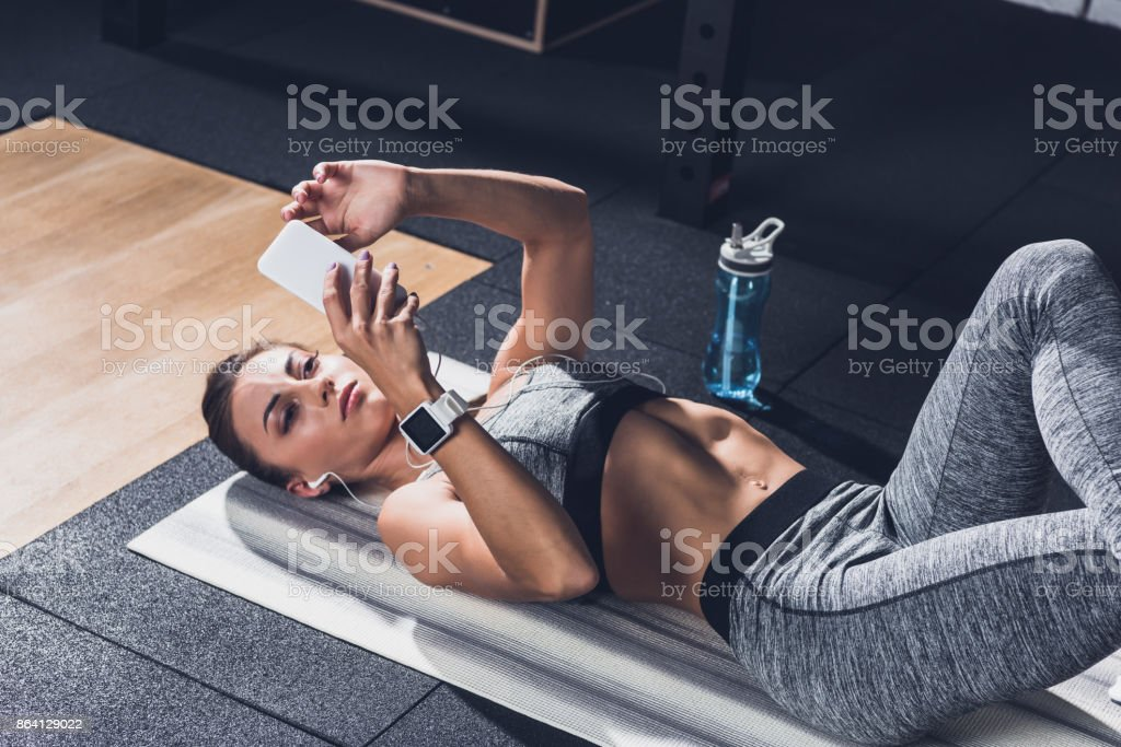 sportive woman using smartphone royalty-free stock photo