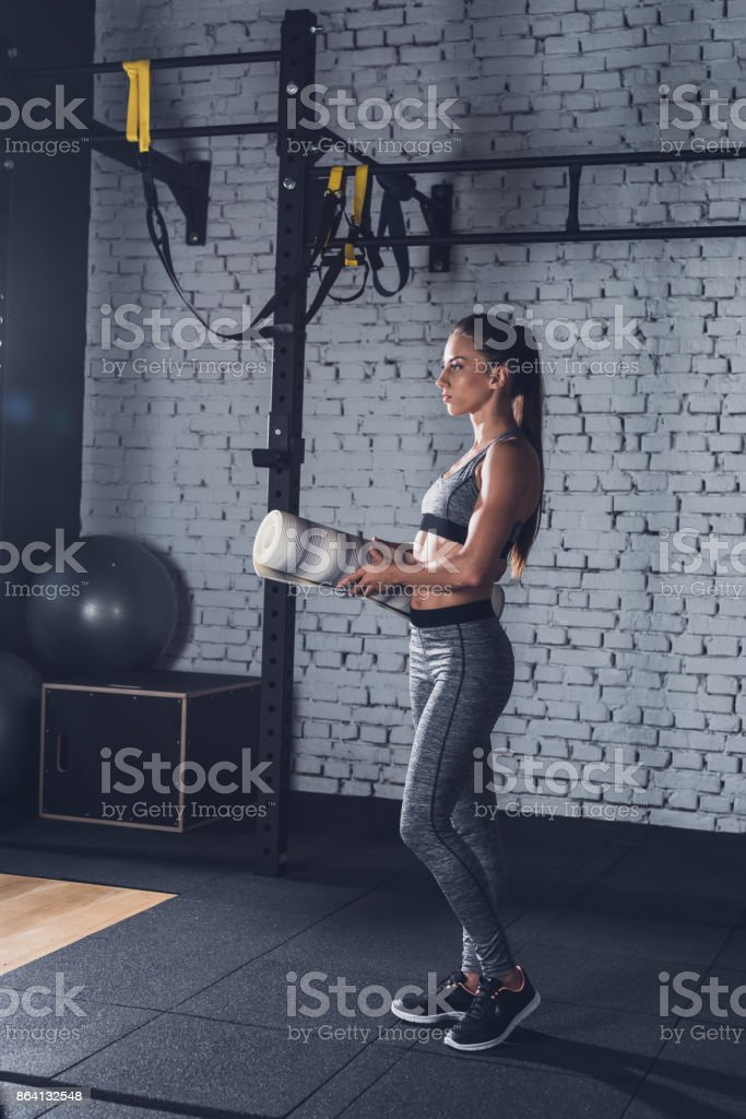 sportive woman with mat royalty-free stock photo