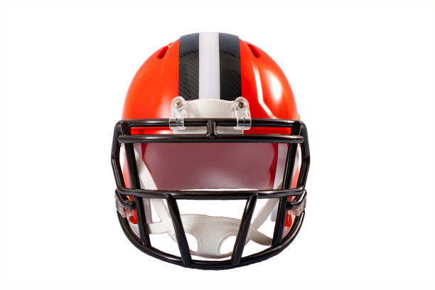 Sports and athletic training concept Sports and athletic training concept with front view of a red or orange american football helmet with black and grey stripe along the crown, isolated on a white background with clipping path american football uniform stock pictures, royalty-free photos & images