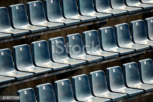 Detail with empty sports arena blue seats