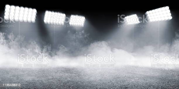 Sports arena with concrete floor with smokes and spotlights picture id1135438312?b=1&k=6&m=1135438312&s=612x612&h=ltafwxdvnscouclkm0cwdfspm5dkhdflwhpjnvzifvo=