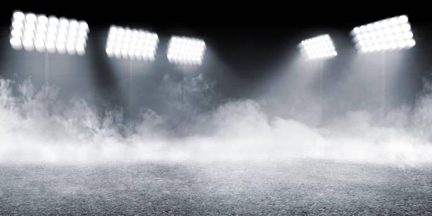 sportarena mit betonboden mit rauchern und scheinwerfern - sport stock-fotos und bilder