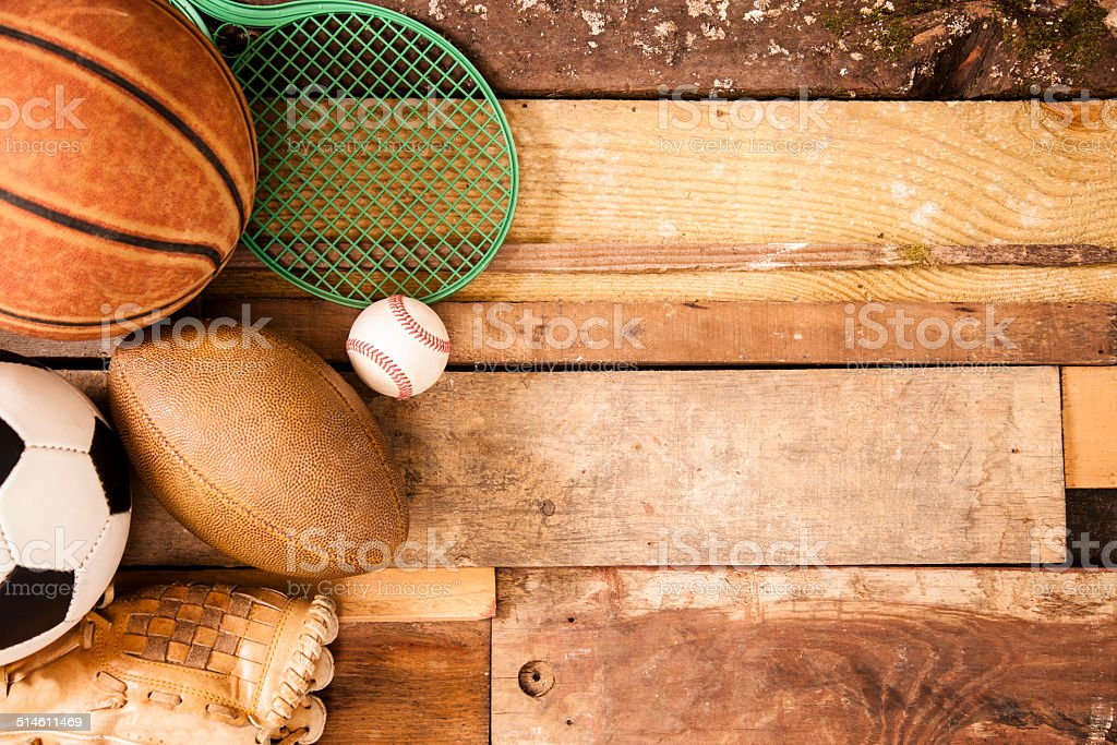 Sports Background: Equipment on unique wooden boards background. stock photo