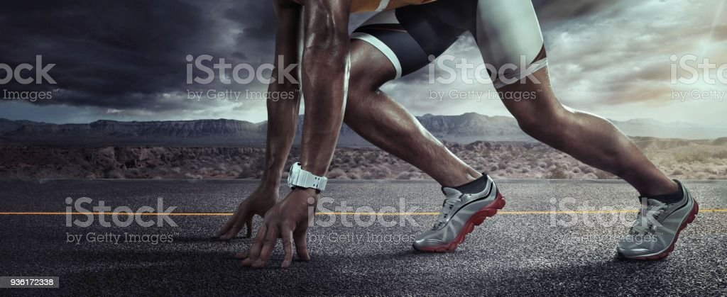 Sports background. Runner feet running on road closeup on shoe. Start line stock photo