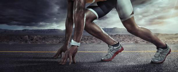 Sports background. Runner feet running on road closeup on shoe. Start line Sport. Runner starting line stock pictures, royalty-free photos & images