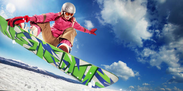 Sports background snowboarder jumping through air with deep blue sky picture id847176856?b=1&k=6&m=847176856&s=612x612&w=0&h=hbcpsgpbmp0fldbaacfxclrokab2rshsr8e5rit8tc0=