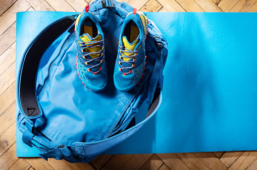 Sports bag and sneakers. Blue duffel bag and blue trainers. Sports composition. Top.
