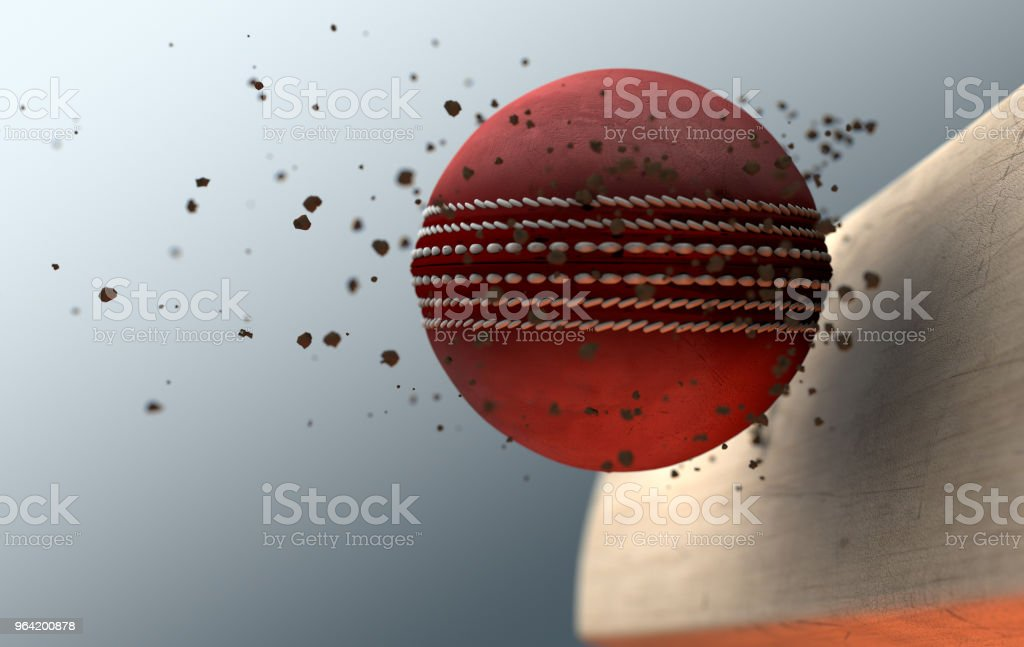 An extreme closeup slow motion action capture of a red cricket ball...