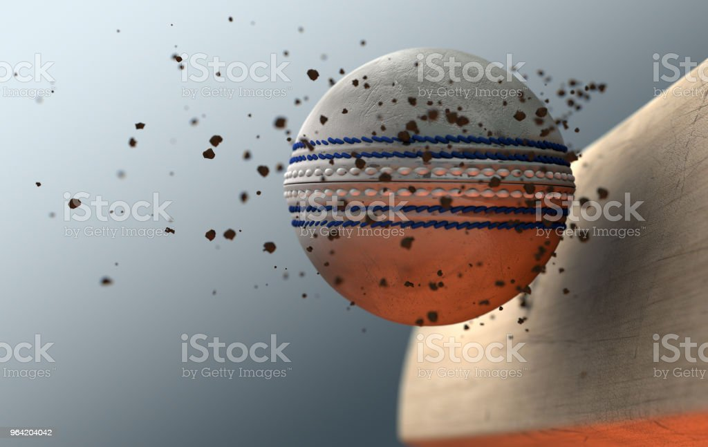 An extreme closeup slow motion action capture of a white cricket ball...