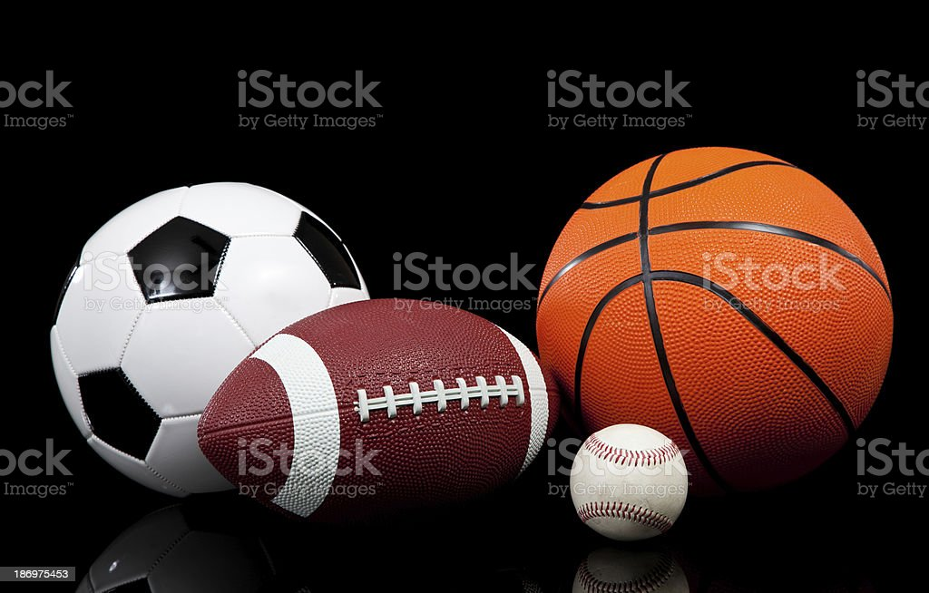 Sports balls on a black background royalty-free stock photo