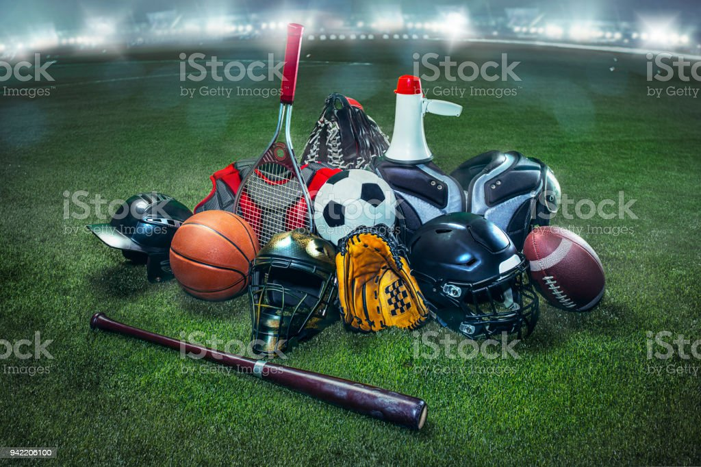 Sports balls on the field with yard line. Soccer ball, American football and Baseball in yellow glove on green grass. Outdoors - foto stock