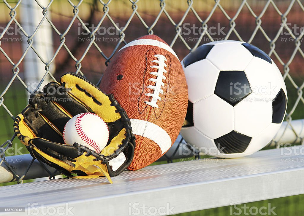 Sports balls. Soccer ball, american football and baseball in yellow...