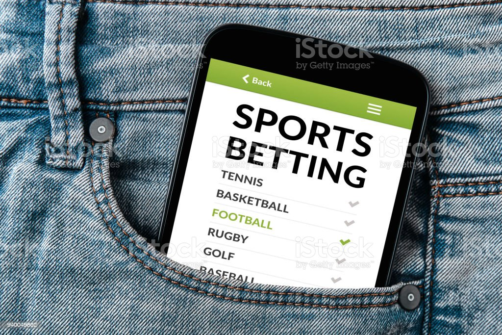 Sports betting concept on smartphone screen in jeans pocket stock photo