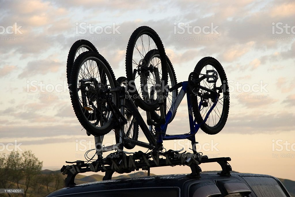 Sports bicycle over jeep royalty-free stock photo