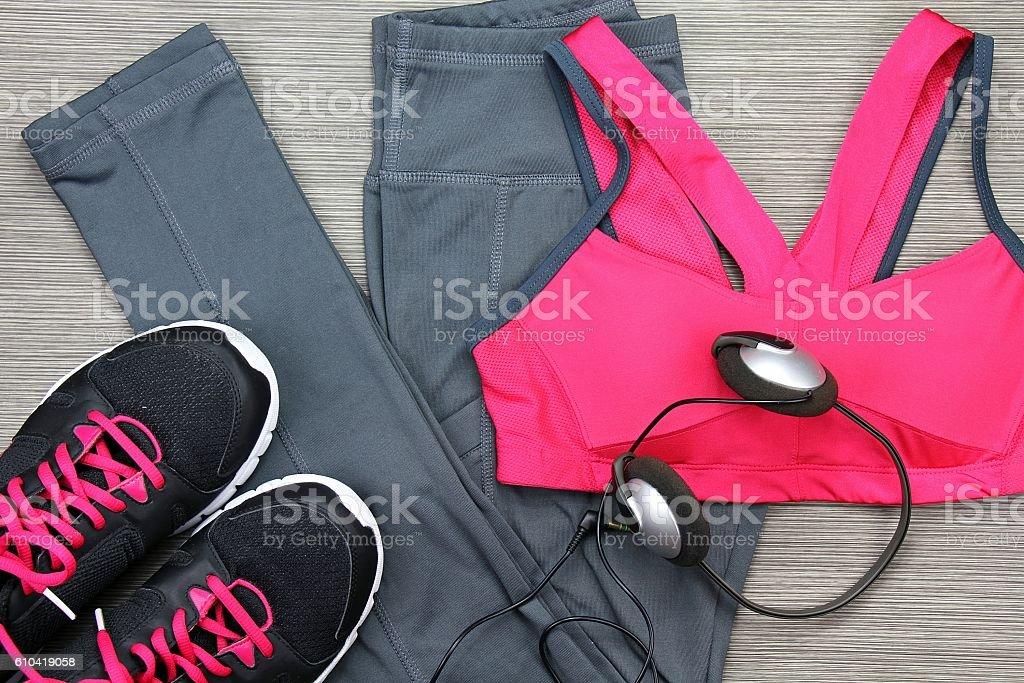 Sports bra, running shoes and headphones to listen music stock photo