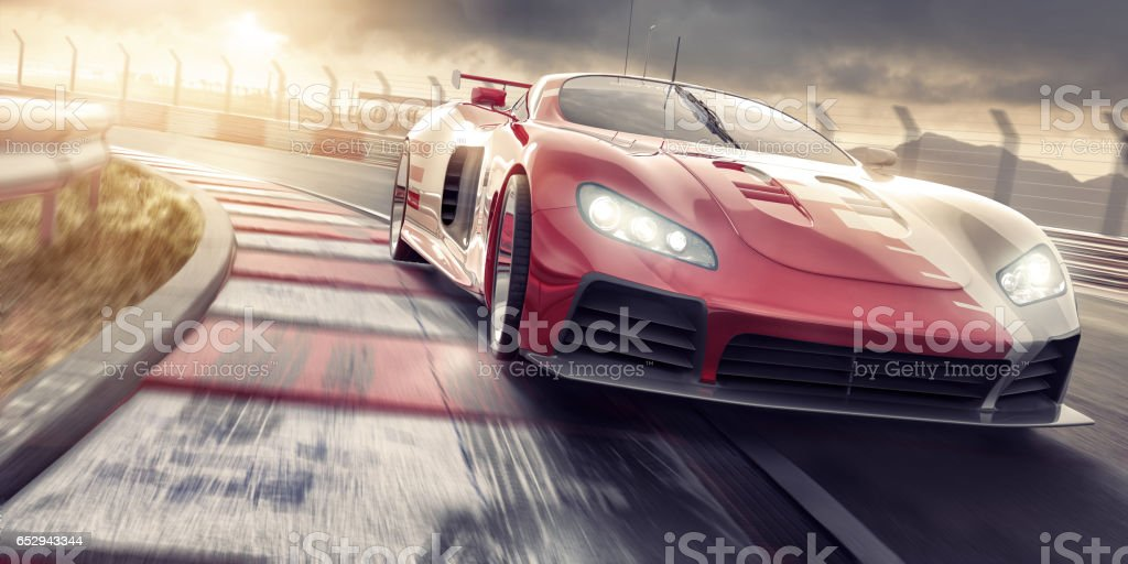 Sports Car Close Up Driving Fast On Racetrack At Sunset stock photo