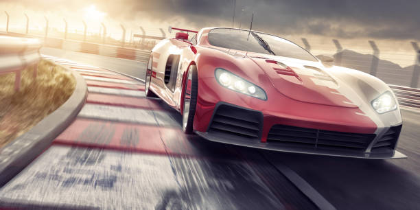 sports car close up driving fast on racetrack at sunset - motorsport stock photos and pictures