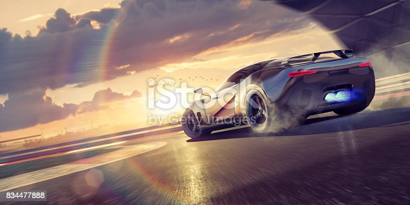 A stylized image of a fictional sports car drifting round bend with smoke coming from tyres as the supercar wheelspins around the corner of a racetrack. The sports car also has blue flames coming from it's exhaust and is driving around a track during a dramatic evening sunset.