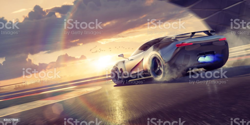 Sports Car Drifting Round Racetrack Bend At Sunset stock photo