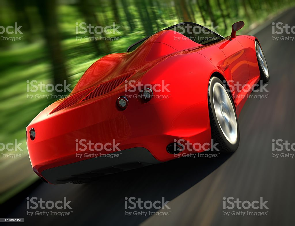 Sports car driving fast in forest royalty-free stock photo
