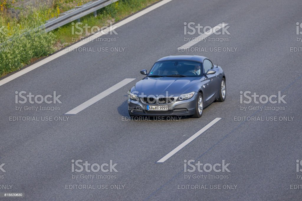 Bmw Sports Car Driving On A German Highway Stock Photo Download