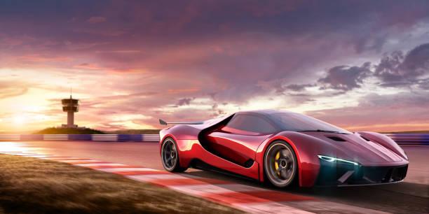 sports car moving at high speed on racetrack at sunset - consumo exibicionista imagens e fotografias de stock