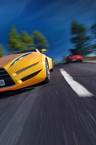Sports car moving on the road stock photo