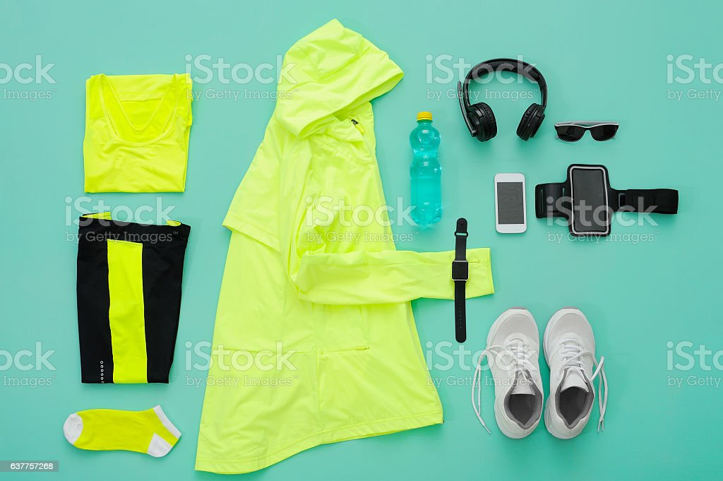Sports clothing and accessories on turquoise background. - foto stock