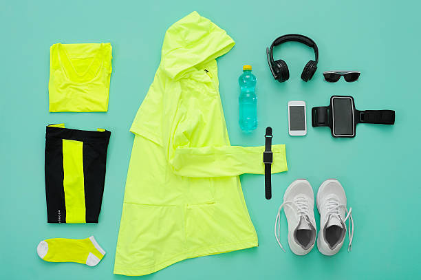Sports clothing and accessories on turquoise background. stock photo