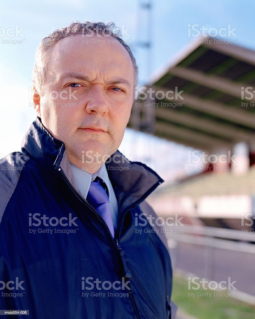 Sports coach in stadium royalty-free stock photo