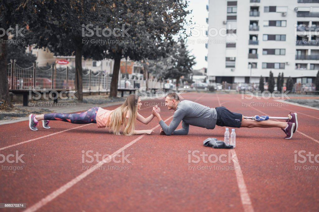 Sports couple training outdoors stock photo