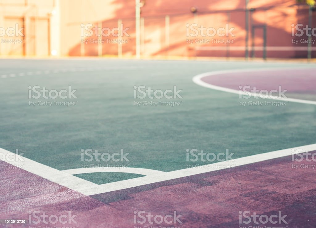 It\'s front view and low angle of a sports court in the sunset. A...