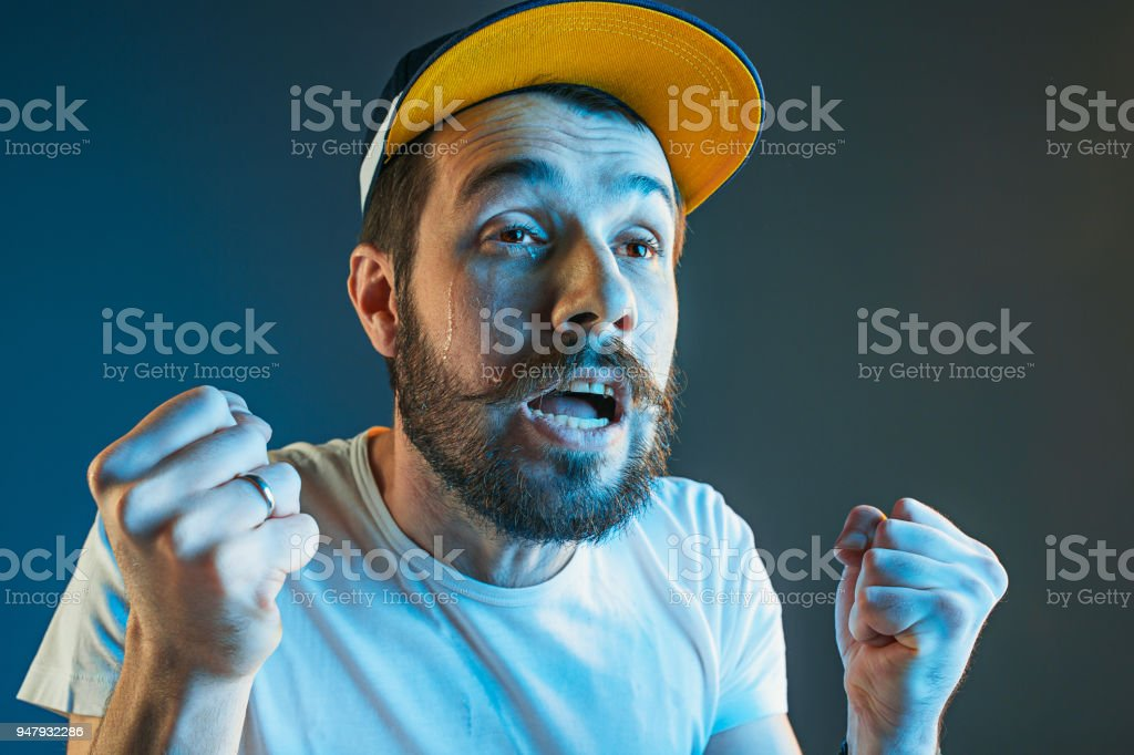 Sports, emotions and fan people concept - sad man watching sports on tv and supporting team at home stock photo