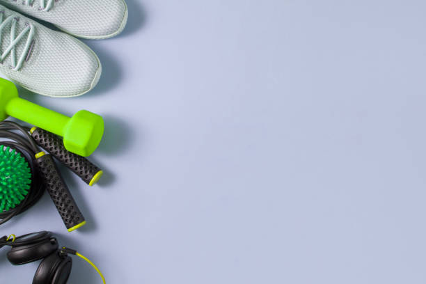 Sports Equipment and Accessories, Shoes, Dumbbells on Green Background stock photo