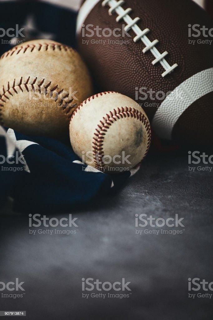 Sports Equipment. Baseball, football and softball still life