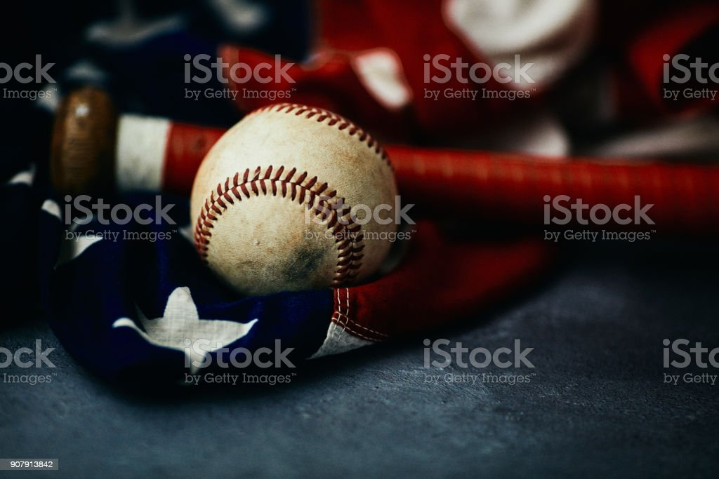 Sports Equipment. Baseball still life, worn ball with bat on American...
